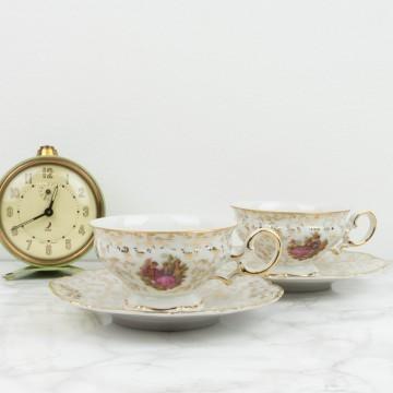 Pareja de tazas y platos de te de porcelana francesa