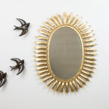Antiguo espejo sol ovalado