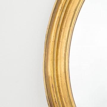 Pequeño espejo ovalado y dorado