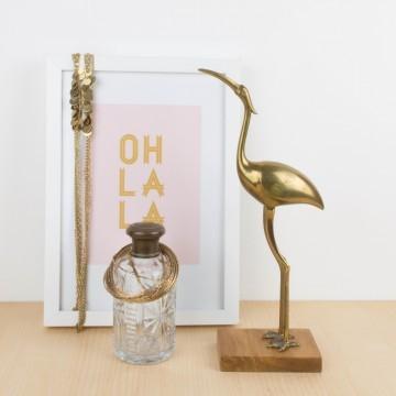 Ibis de bronce con base de madera