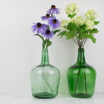 Damajuana pequeña de vidrio verde transparente